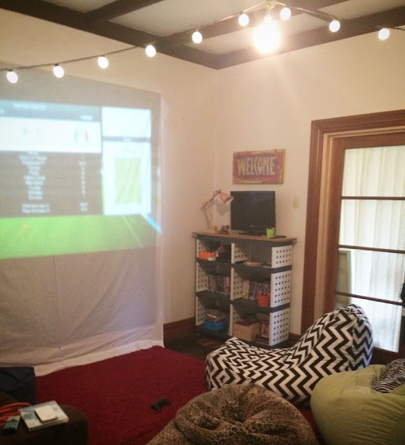 The sleepover space - with PS3 hooked up to projector and controllers for all