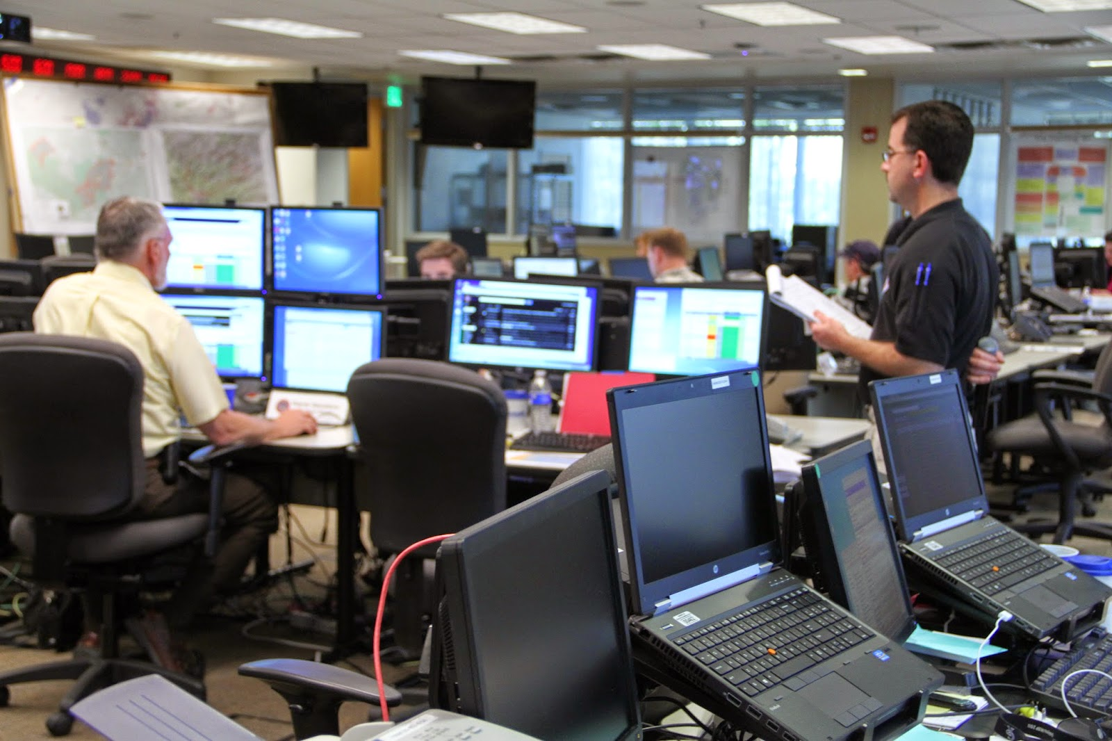 Chris Sorensen leads a State EOC briefing call during 2013 activation.