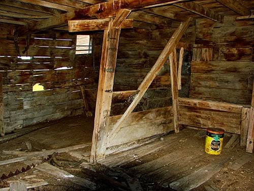 Old stall still visible Inside a historic, abandoned barn