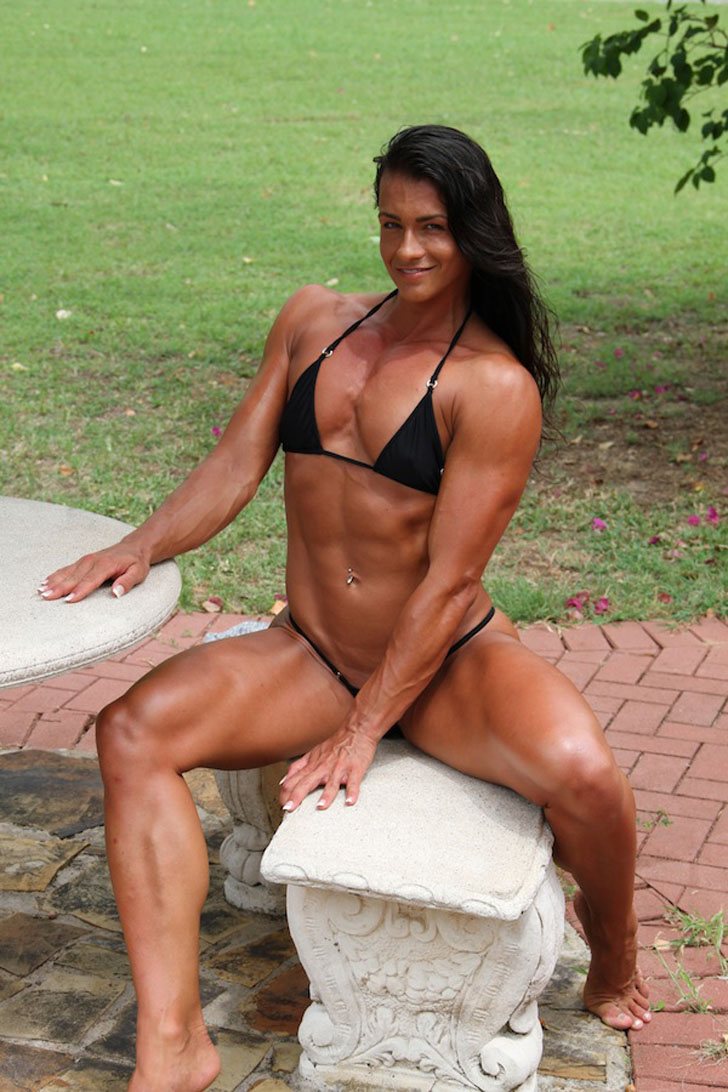 Cindy Landolt Models Her Muscular Legs And Physique In A Black Bikini