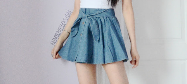 Yumart's waist-bow denim skirt is super versatile and easy to style, making it a fashion staple for lovers of cute Asian clothing.