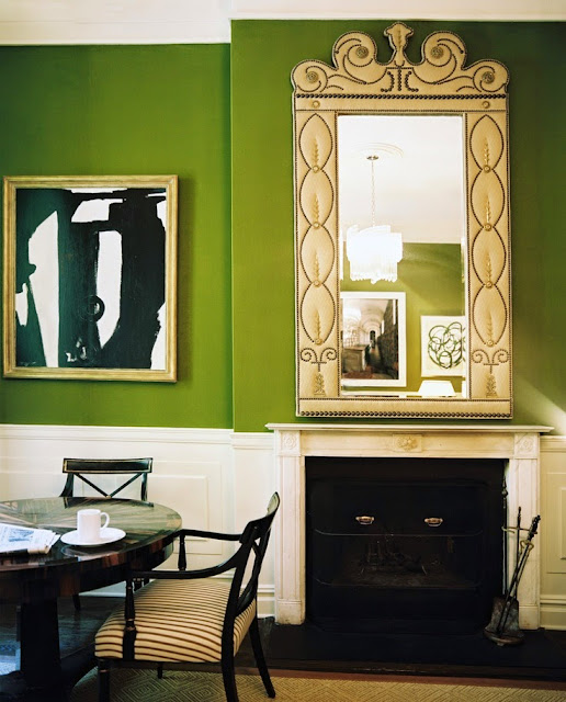 beautiful traditional style decor white walls pop of bright green dining room round table