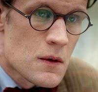 Matt Smith wearing round glasses