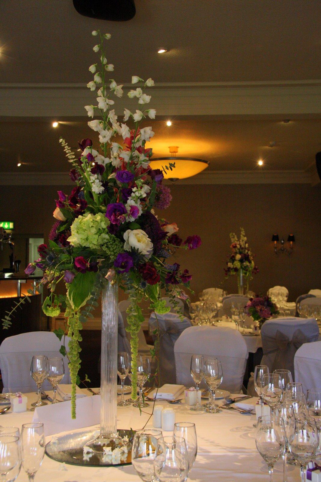 Flower design table centrepieces glass candlestick table for Black table centrepieces