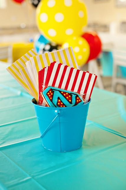 Napkins and centerpiece bucket from Flashback Friday: Superhero Birthday Party at Kara's Party Ideas