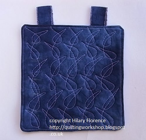 original free motion quilting design sample on hand-dyed indigo fabric