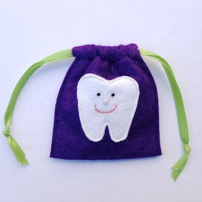 Happy Embroidered Tooth Pouch