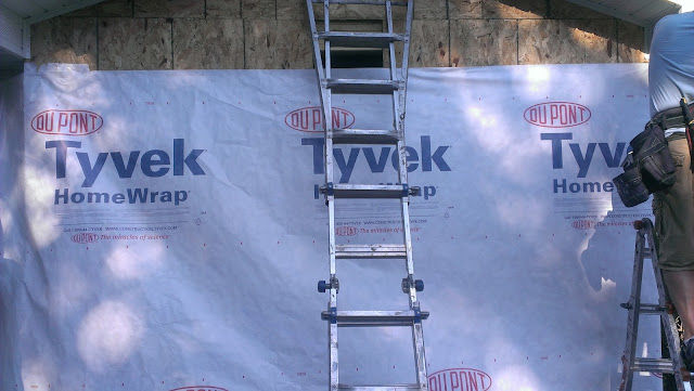 Tyvek house wrap going on around the outside of the sauna.