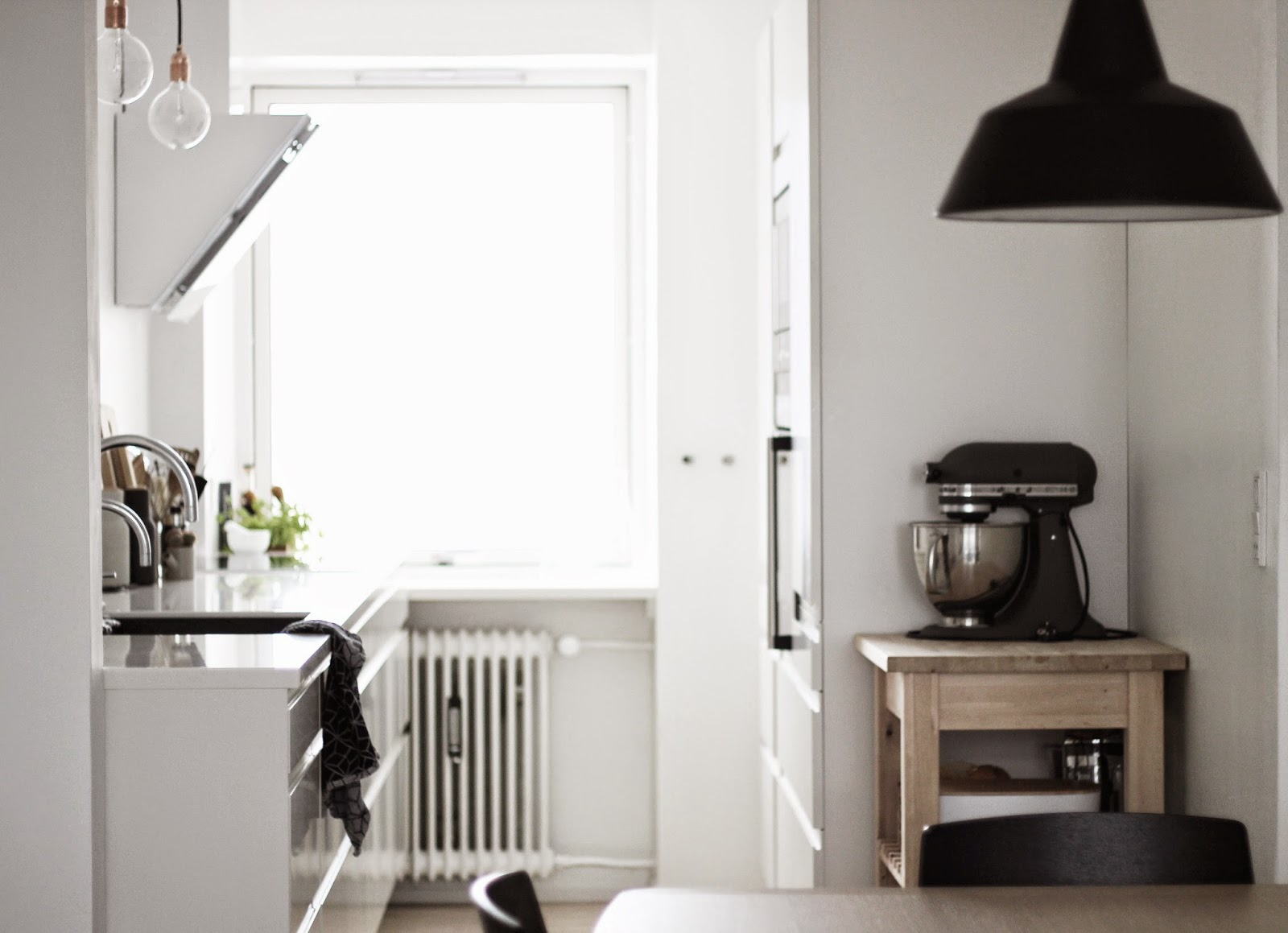 kitchen makeover, kitchen before and after pictures, kitchen renovation, diy, scandinavian interior, white kitchen, corian counter top, black sink, via http://www.scandinavianlovesong.com/