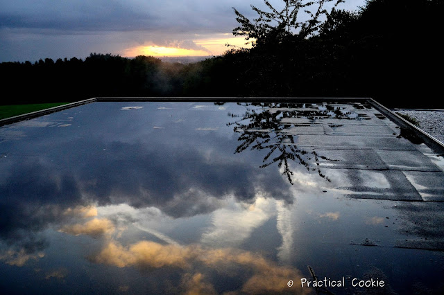 Sunset and reflections in puddles on a roof
