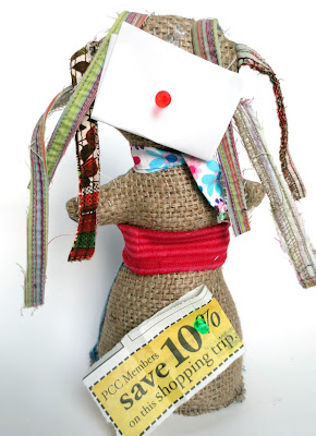 bulletin board -- Rag doll repurposed from fabric scraps, denim and burlap