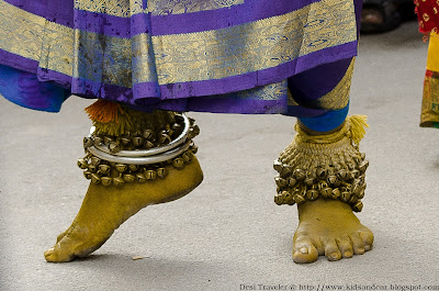 a pothuraju dancer with anklets bonalu
