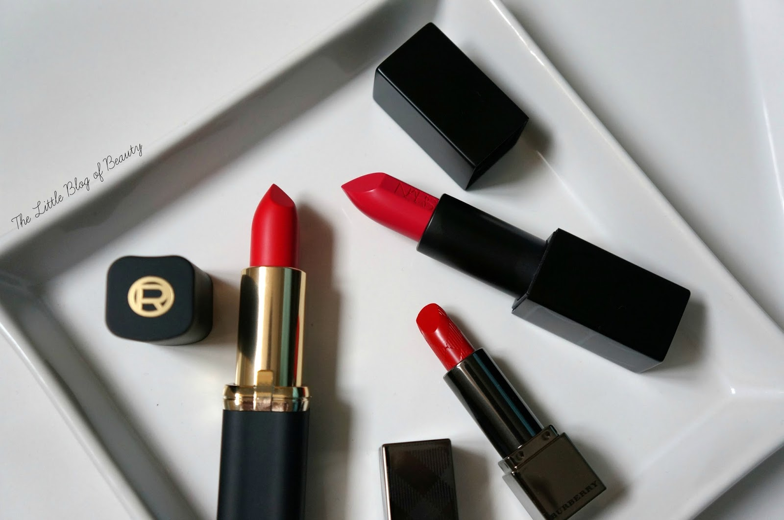 NARS Audacious Greta, L'Oreal Collection Exclusive Pure red by Julianne and Burberry Kisses in Military red