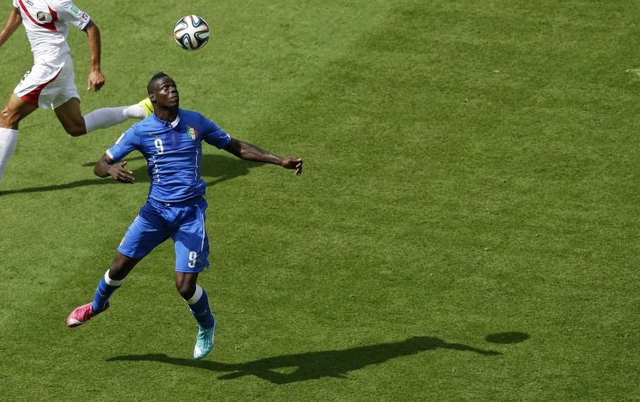 Italy's Mario Balotelli controls the ball during the group D World Cup soccer match between Italy and Costa Rica at the Arena Pernambuco in Recife, Brazil, Friday, June 20, 2014.