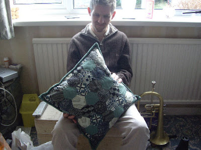photo of me with my new haircut and holding a beautiful handmade cushion