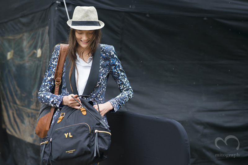 Model Yumi Lambert holding Burberry Prorsum Backpack after 2016 Spring Summer show during London Fashion Week LFW