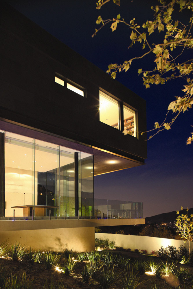 Facade of Modern contemporary CT House in Mexico at night