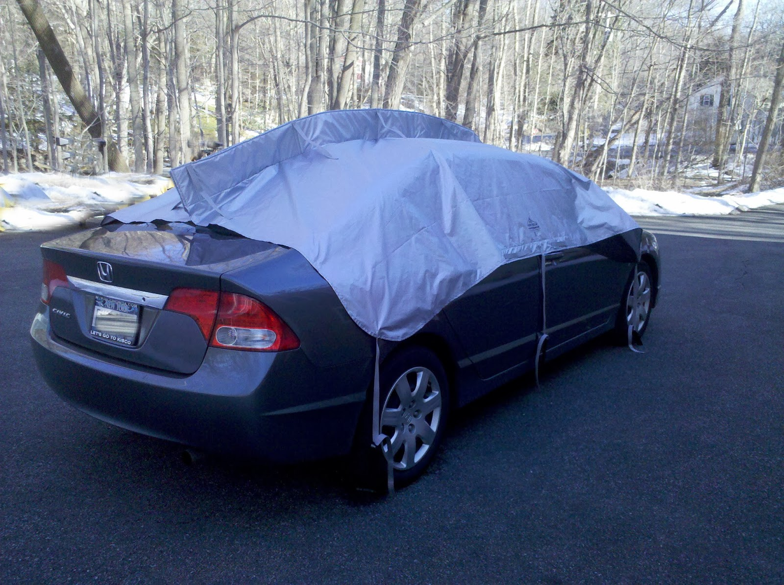 Warming Up Car With Car Cover On