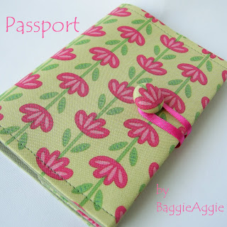 Pretty ladies' passport wallet in a contemporary floral fabric in pink and green.