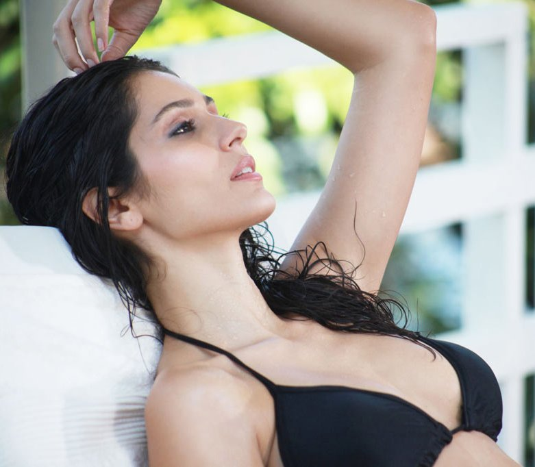 Parvathy Omanakuttan Burns Up The Beach in a Bikini