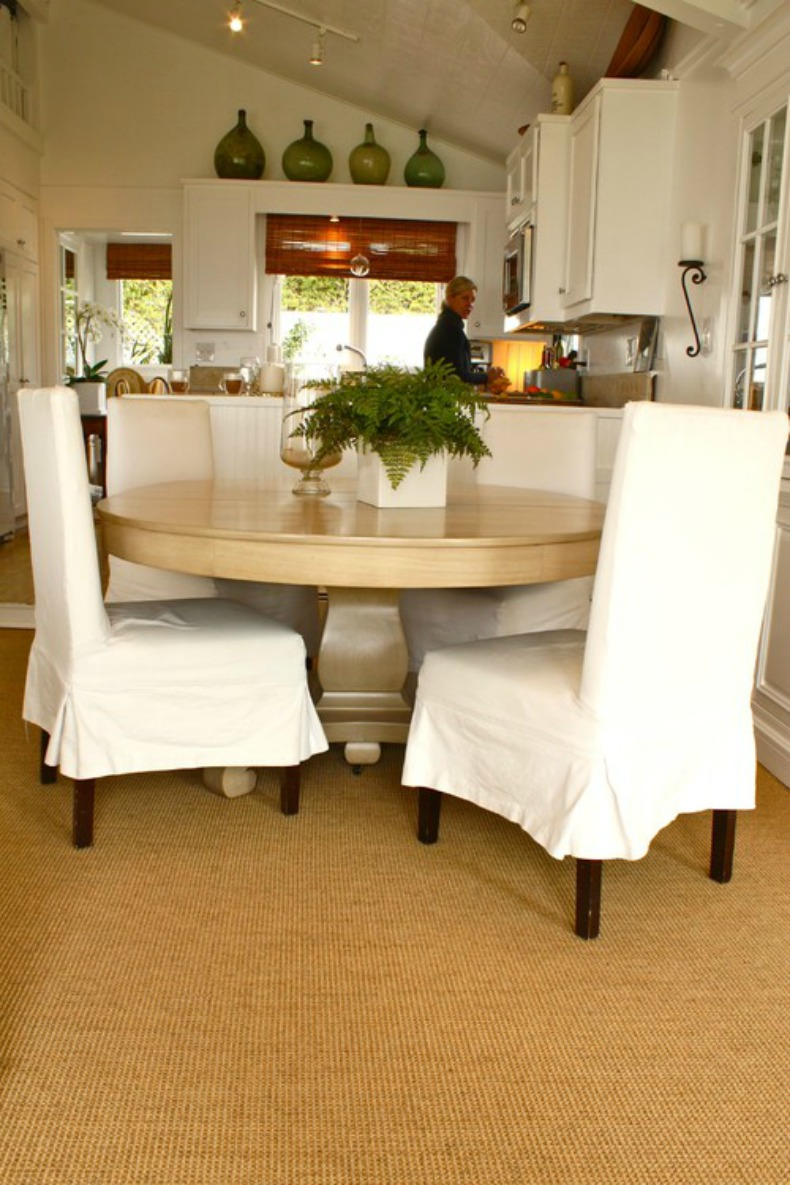 Coastal dining room with white slipcover dining chairs