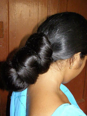 Trichy lady with huge thick oiled long hair bun.