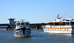 TRUE NORTH and Yacht AMERICA hover at Onslow Bridge.