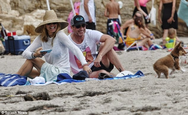 The pair were spotted enjoying a few days alone with a cute pet during a beach getaway in Malibu, California, USA on Saturday, June 28, 2014.