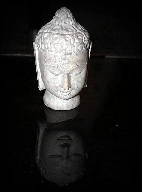 Buddha Face Made of stone