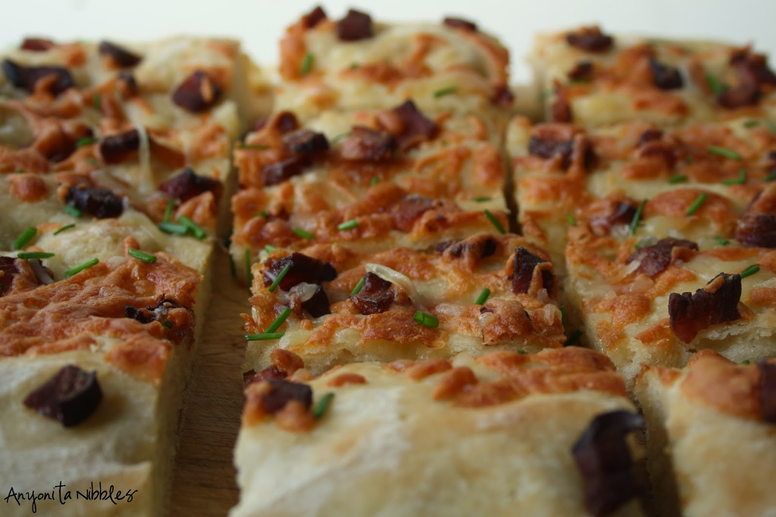 Focaccia made with potatoes and topped with cheese, chives and bacon from Anyonita Nibbles