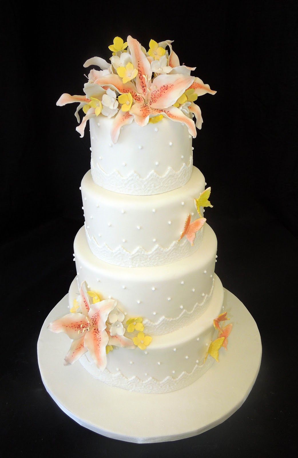 Cake Fiction: Stargazer Lily Wedding Cake with lace ribbon and sugar ...