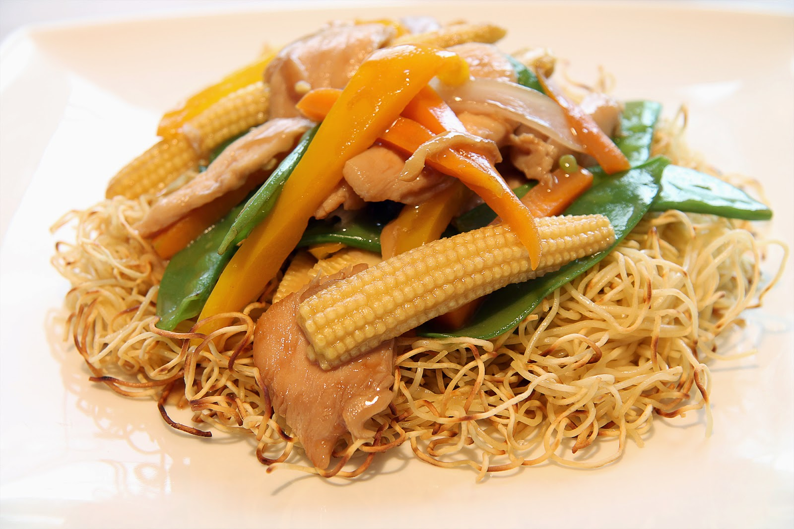 chicken stir fry on crispy noodles