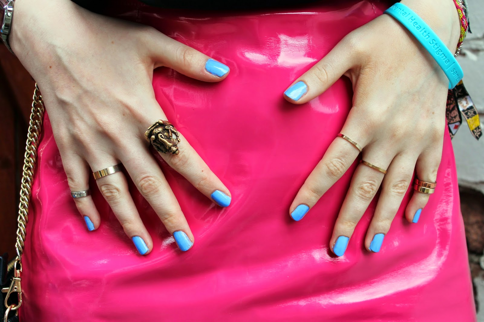 pink pvc mini skirt with mint nails and stacked rings from topshop and primark including ganesh ring