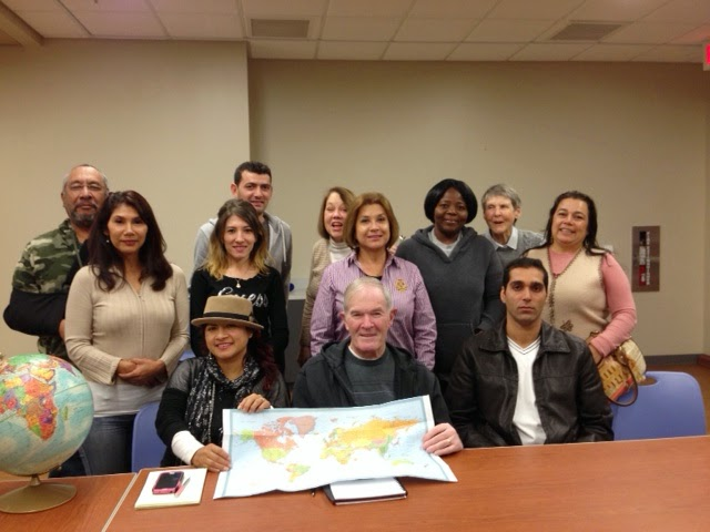 Olney Library English Conversation Group with globe and map