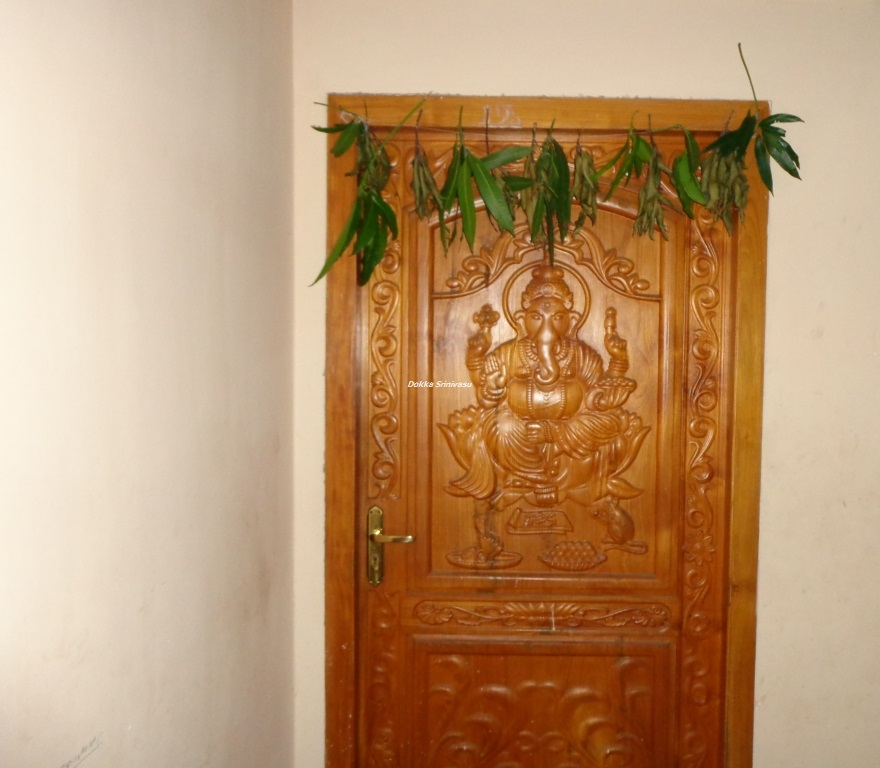 Heritage of india lord ganesha wooden door carving photograph for Indian main double door designs