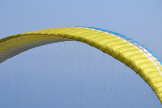 Blue and yellow paragliding