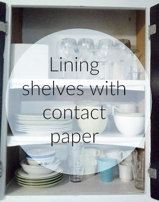 Lining shelves with contact paper, kitchen cabinets