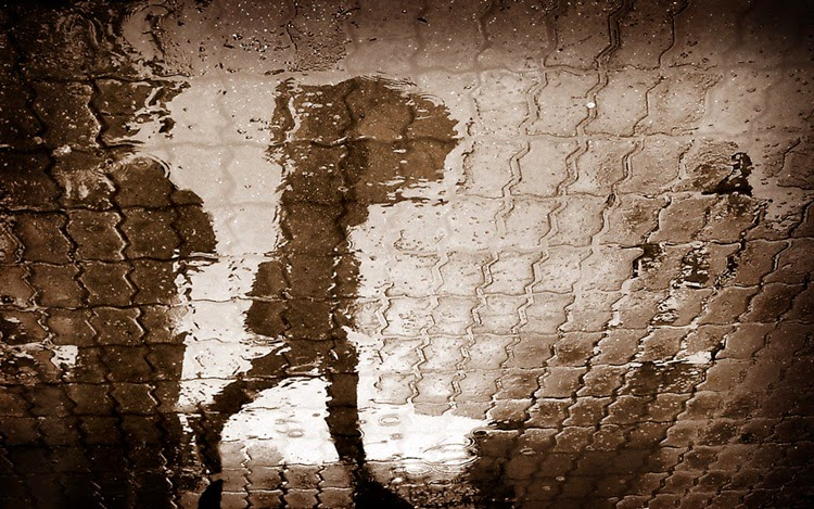 Shawdow of Men With Umbrella in Rain