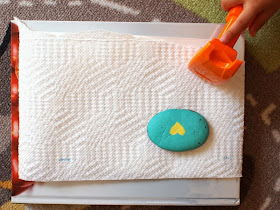 Place paper towel on top use rock or hammer to pound