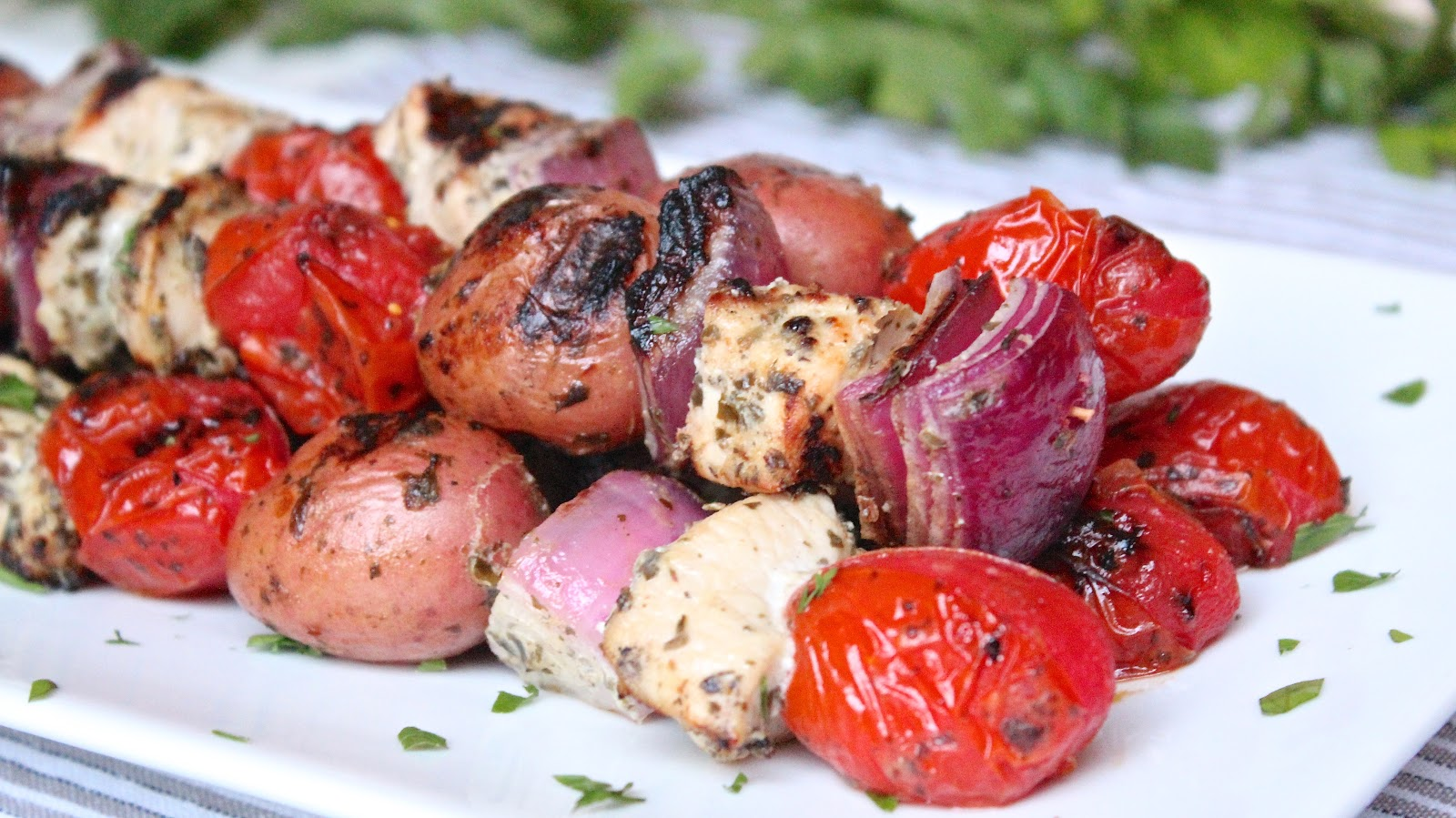 of a chicken and pesto potato salad, grilled on skewers. Baby potatoes ...