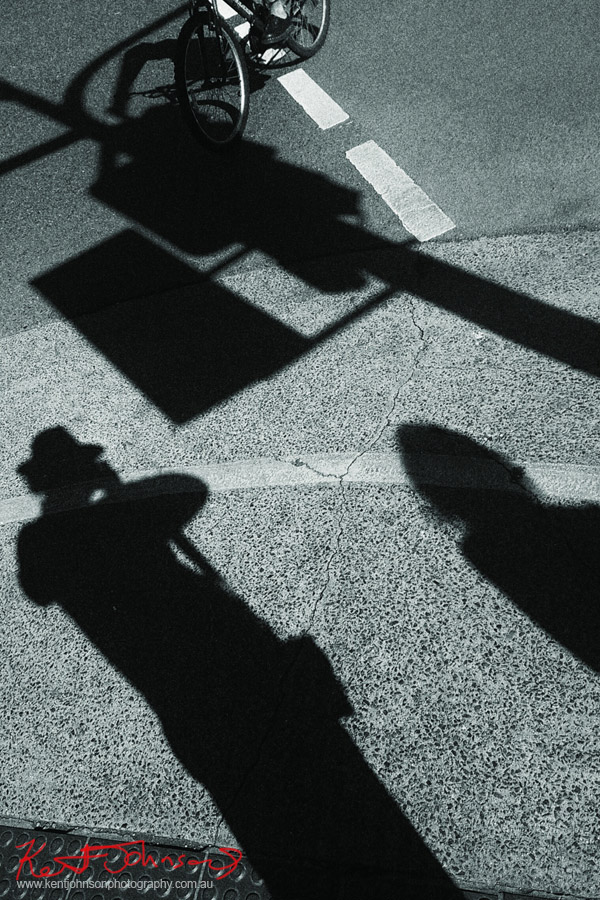 Sharply detailed shadows on a Brisbane street. Photo by Kent Johnson.
