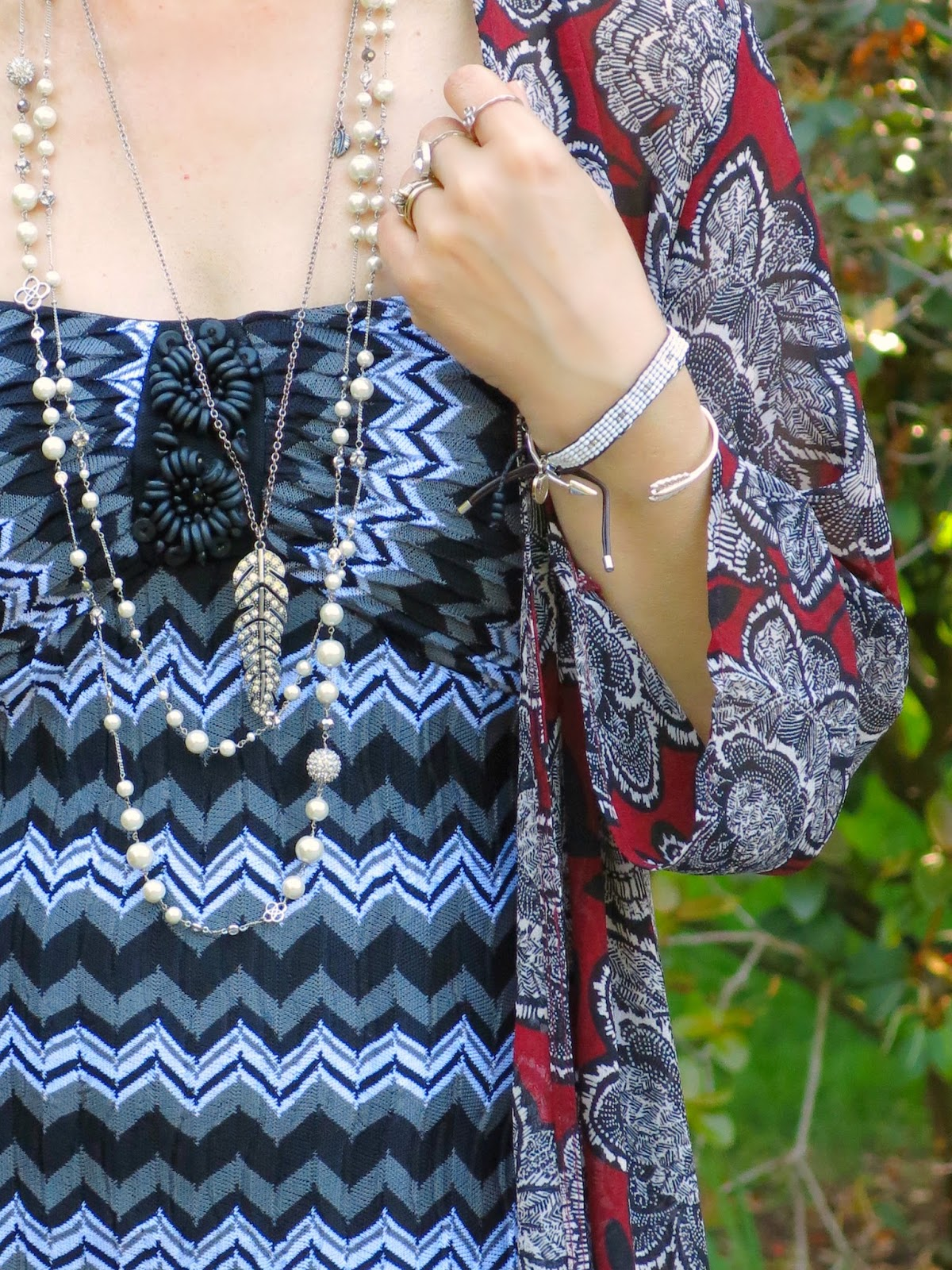 A striped maxi dress with a floral chiffon kimono and accessories
