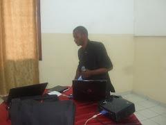 Dr Mateus en presentation dans la conference sur le cancer du col uterin a goma