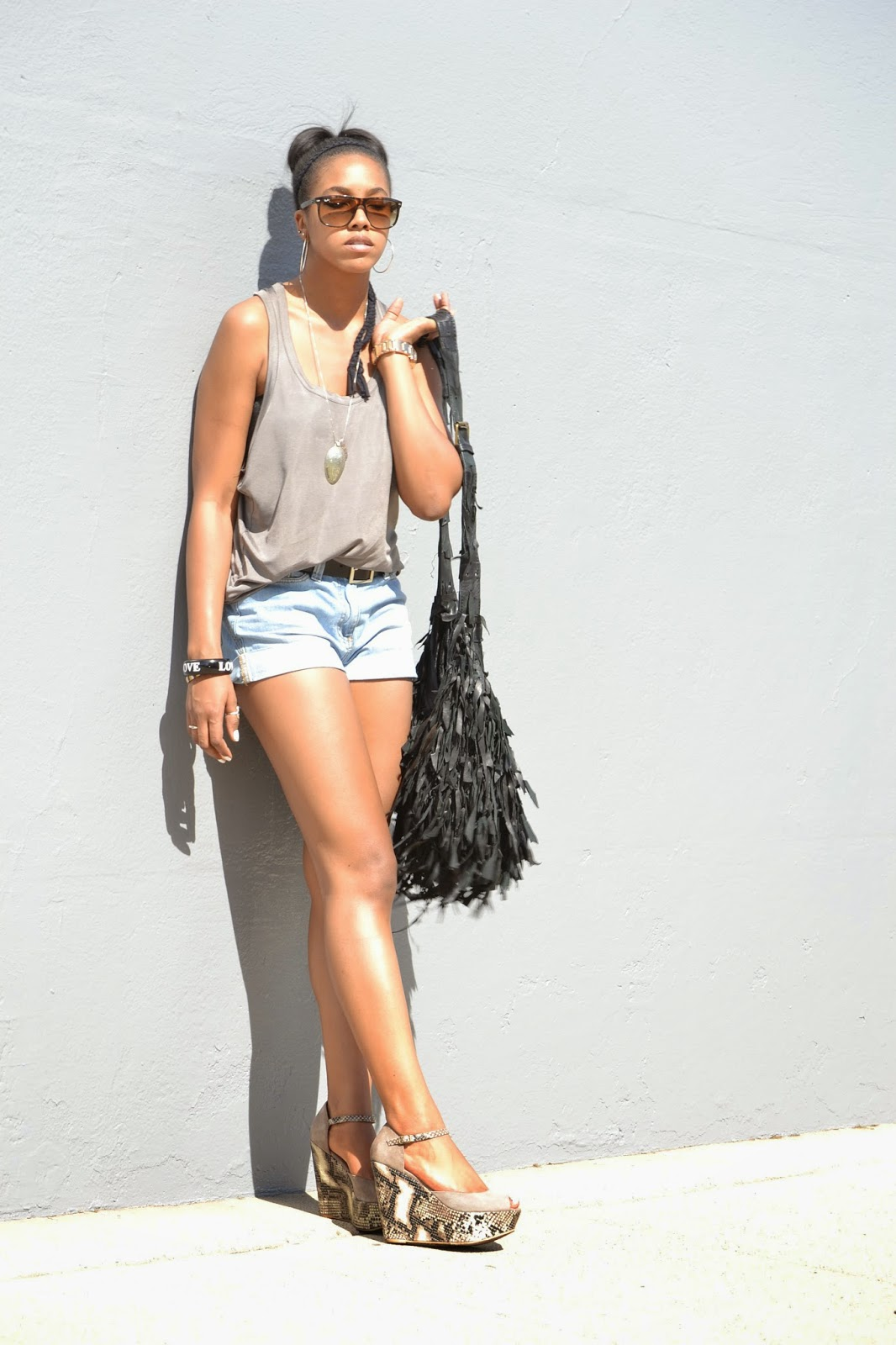 Wearing Reiss oversized tank with Reiss high waisted denim shorts