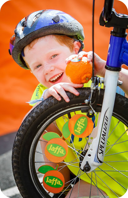 Little boy enjoying Jaffa Fruit at a Sky Ride event