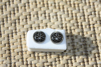Black with white etched flower, silver rimmed