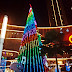 a night at the tallest chrismast tree with sparkling led light at central park, jakarta