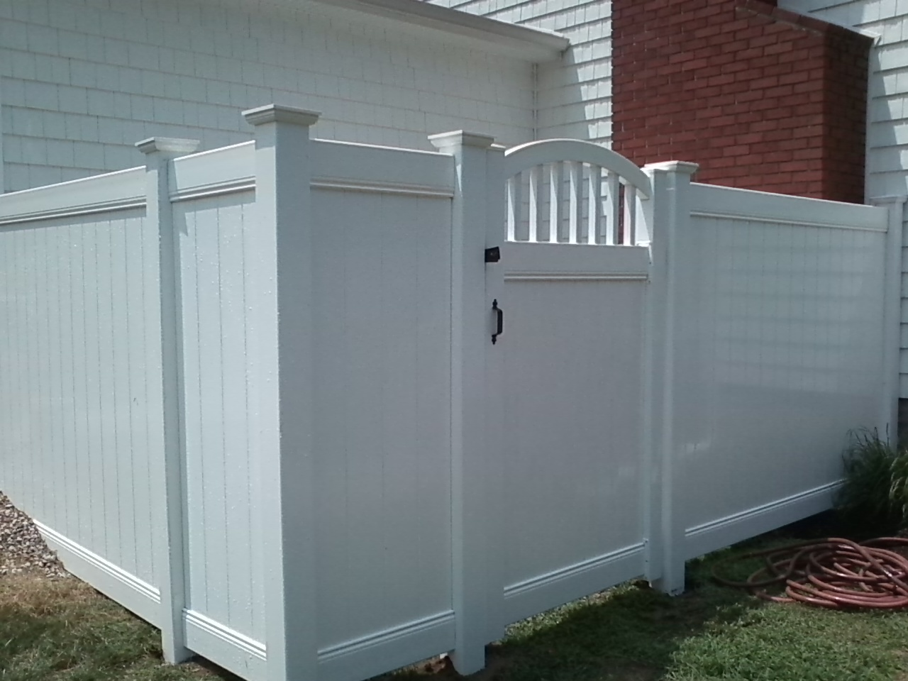 Home remodeling and improvements tips and how tos white vinyl vinyl privacy fencing with custom arch gate baanklon Gallery