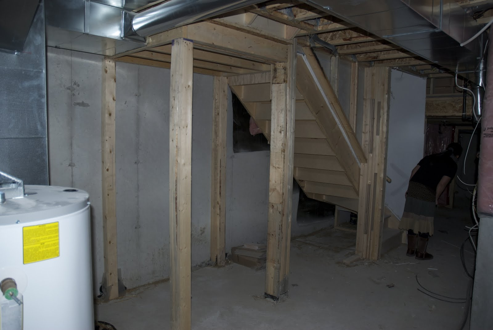 unfinished basement storage ideas. That is the space under stairs  looks like a storage for me Right HouSeOnaShoestring Unfinished Basement Decorating
