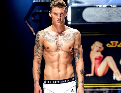 runway model with tattoos shirtless